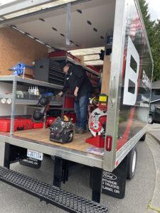 technician-in-back-of-truck
