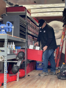 technician-getting-tools-from-back-of-service-truck
