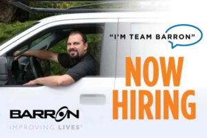 technician-in-barron-van-and-text-that-says-i'm-team-Barron-now-hiring